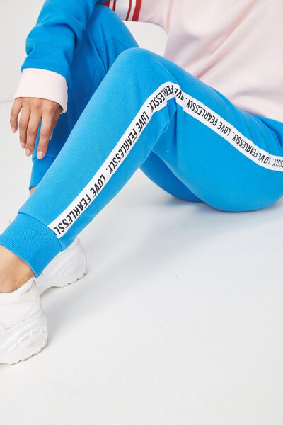 Adele Trackpant, BRILLIANT BLUE/LOVE FEARLESSLY SIDE TAPE