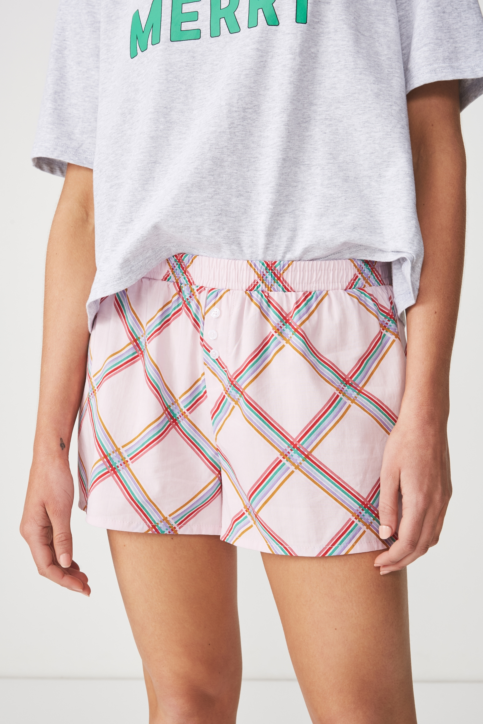 Pyjama shorts should always be as fun as the Bedtime Fun Shortie. This pyjama short is available in a range of prints and colours and features a mid-ride waistline. Mix and match with our pyjama tops for a cute summer pyjama set. - Mid rise - Short length - Elasticated waistband - Decorative drawcord - Decorative fly - Woven fabric MODEL WEARS SIZE: SMALL - AU 10 US 6 EUR 38 55% COTTON 45% VISCOSE
